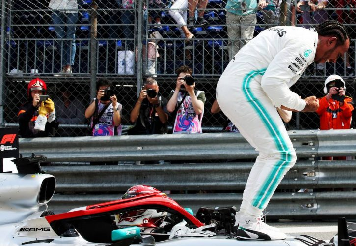 Lewis Hamilton (GBR) Mercedes AMG F1 W10 celebrates his pole position in qualifying parc ferme.