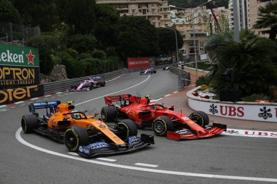 Lando Norris (GBR) McLaren MCL34 and Charles Leclerc (MON) Ferrari SF90.
