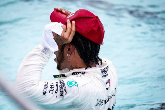 Race winner Lewis Hamilton (GBR) Mercedes AMG F1 celebrates in the swimming pool.