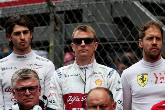(L to R): Antonio Giovinazzi (ITA) Alfa Romeo Racing; Kimi Raikkonen (FIN) Alfa Romeo Racing; Sebastian Vettel (GER) Ferrari, on the grid.