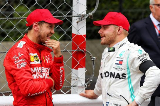 (L to R): Sebastian Vettel (GER) Ferrari in parc ferme with Valtteri Bottas (FIN) Mercedes AMG F1.