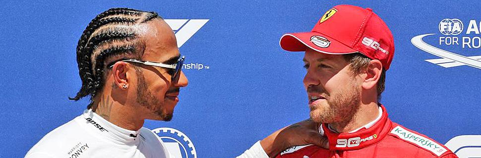 (L to R): Lewis Hamilton (GBR) Mercedes AMG F1 with pole sitter Sebastian Vettel (GER) Ferrari in qualifying parc ferme.