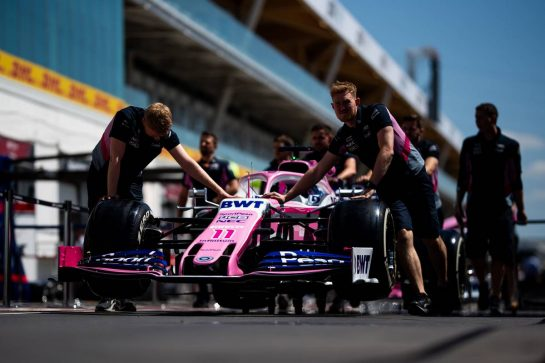 Racing Point F1 Team RP19 of Sergio Perez (MEX) is pushed down the pit lane by mechanics.