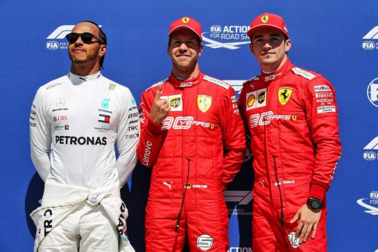 Qualifying top three in parc ferme (L to R): Lewis Hamilton (GBR) Mercedes AMG F1, second; Sebastian Vettel (GER) Ferrari, pole position; Charles Leclerc (MON) Ferrari, third.