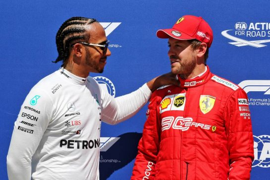 (L to R): Lewis Hamilton (GBR) Mercedes AMG F1 with pole sitter Sebastian Vettel (GER) Ferrari in qualifying parc ferme.