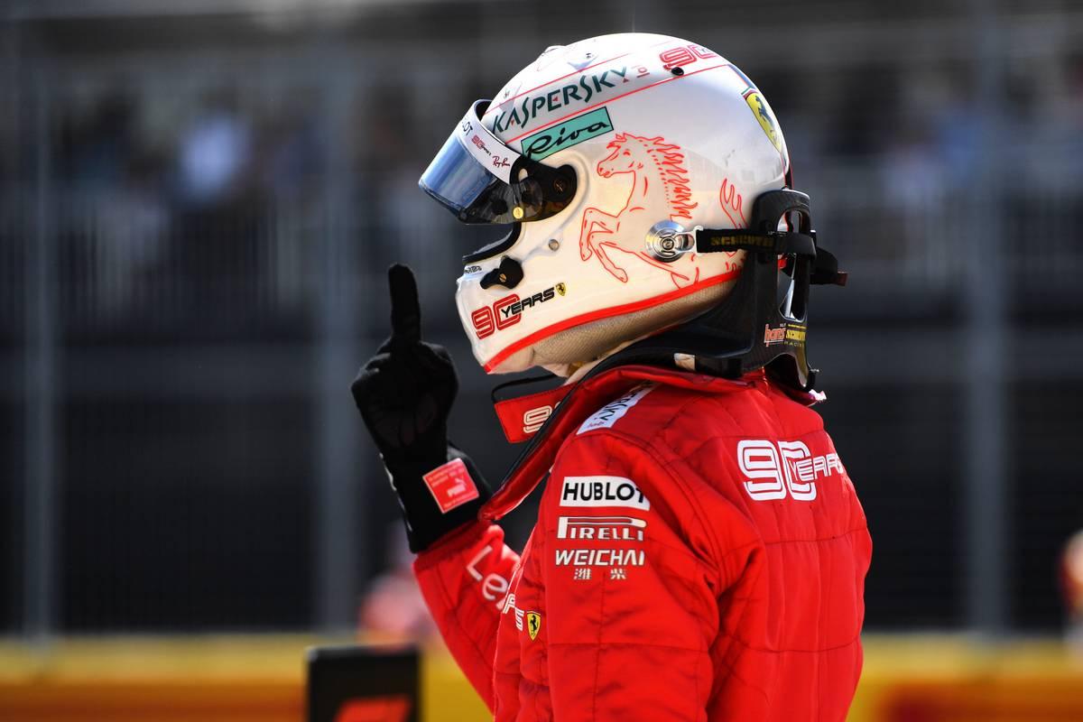 Sebastian Vettel (GER) Ferrari celebrates his pole position in qualifying parc ferme.
