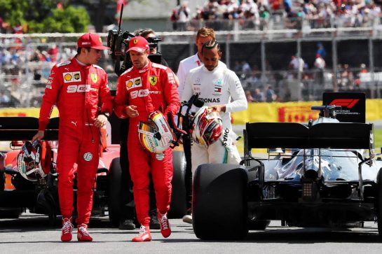 (L to R): Sebastian Vettel (GER) Ferrari; Charles Leclerc (MON) Ferrari; and Lewis Hamilton (GBR) Mercedes AMG F1, in qualifying parc ferme.