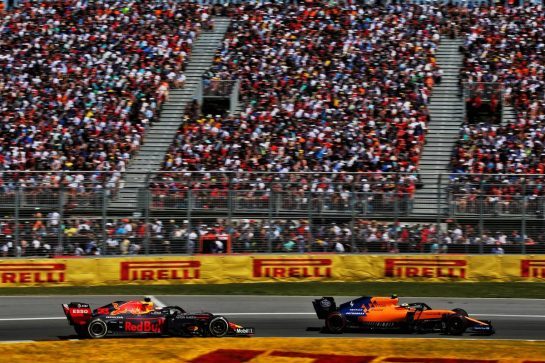 Lando Norris (GBR) McLaren MCL34 leads Max Verstappen (NLD) Red Bull Racing RB15.