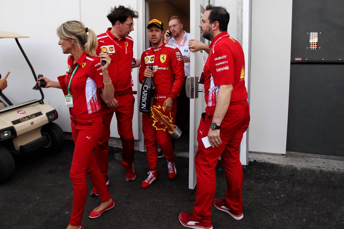 Sebastian Vettel (GER) Ferrari with Britta Roeske (AUT) Ferrari Press Officer and Mattia Binotto (ITA) Ferrari Team Principal at the end of the race.