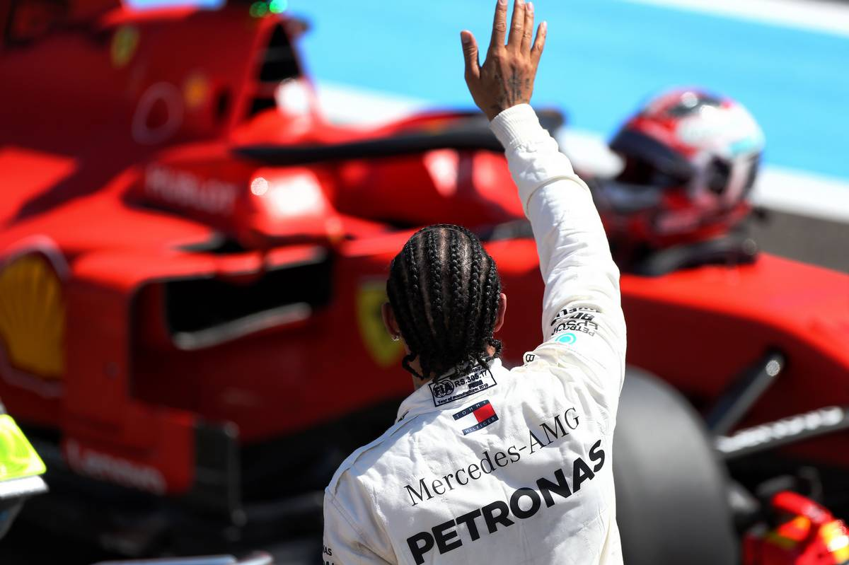 Lewis Hamilton (GBR) Mercedes AMG F1 celebrates his pole position in qualifying parc ferme.