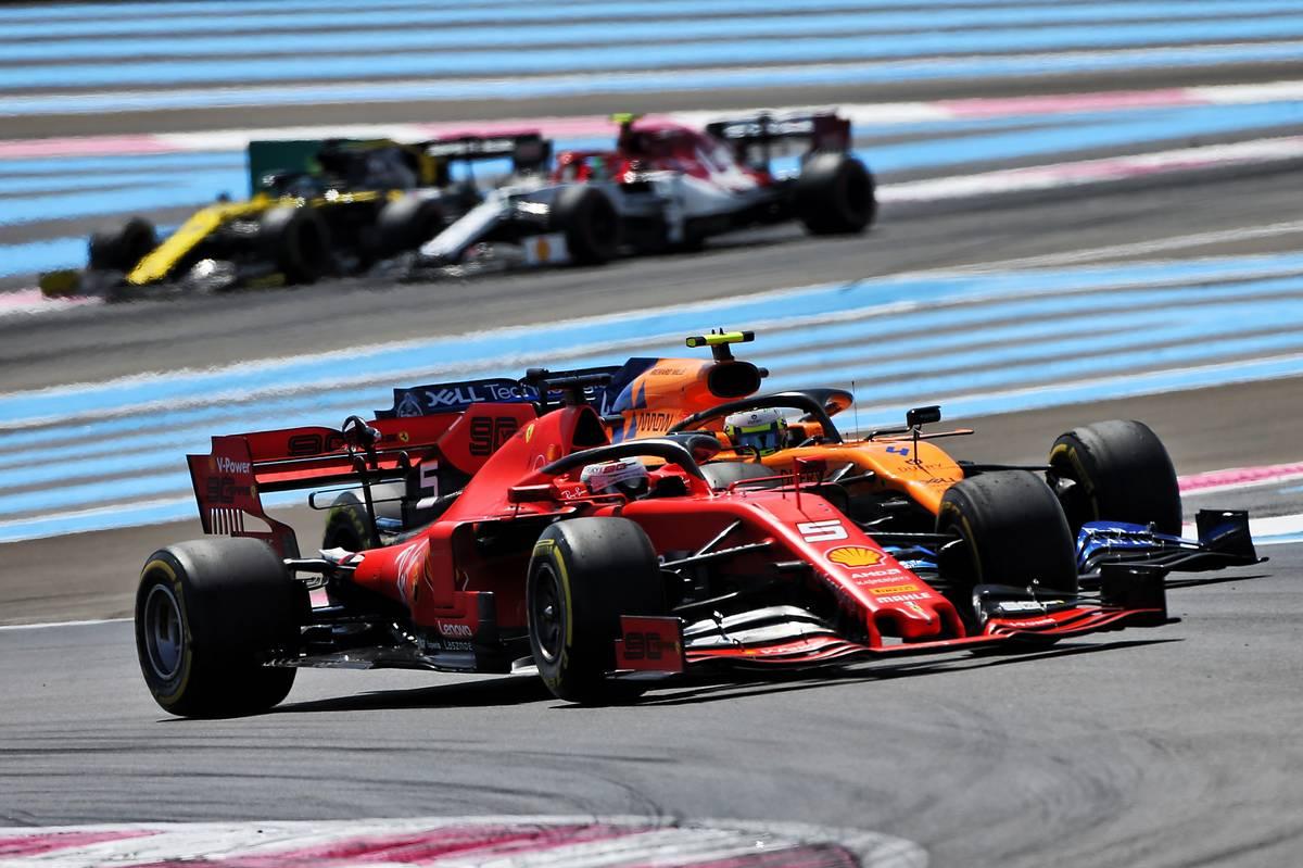 Sebastian Vettel (GER) Ferrari SF90 and Lando Norris (GBR) McLaren MCL34 battle for position.