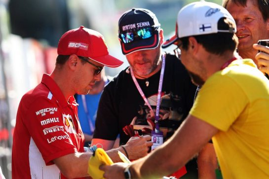 Sebastian Vettel (GER) Ferrari signs autographs for the fans. 28.06.2019. Formula 1 World Championship, Rd 9, Austrian Grand Prix, Spielberg, Austria, Practice Day. - www.xpbimages.com, EMail: requests@xpbimages.com - copy of publication required for printed pictures. Every used picture is fee-liable. © Copyright: Moy / XPB Images