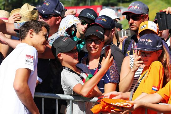 Lando Norris (GBR) McLaren with fans.