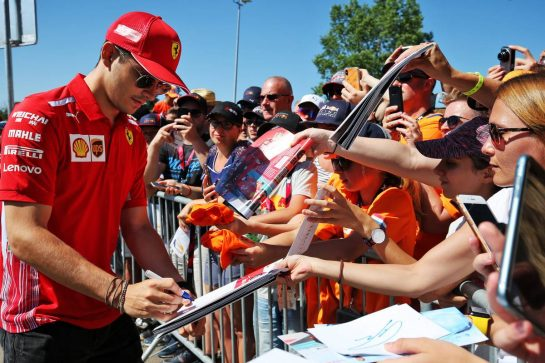 Charles Leclerc (MON) Ferrari signs autographs for the fans.