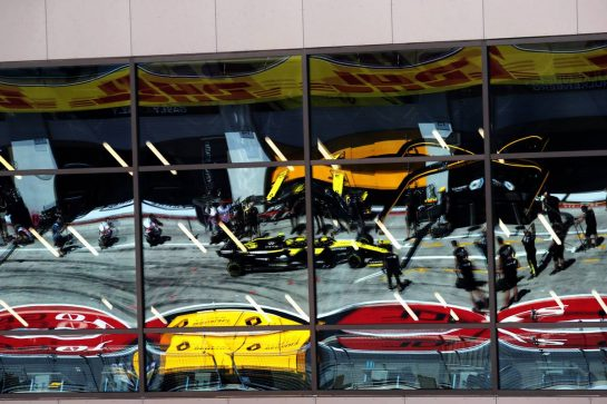 Nico Hulkenberg (GER) Renault F1 Team RS19 reflected in pit building windows.