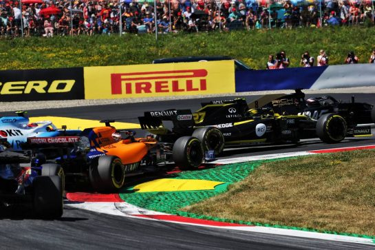 Nico Hulkenberg (GER) Renault F1 Team RS19 and Carlos Sainz Jr (ESP) McLaren MCL34 at the start of the race. 30.06.2019 Formula 1 World Championship, Rd 9, Austrian Grand Prix, Spielberg, Austria, Race Day.  - www.xpbimages.com, EMail: requests@xpbimages.com - copy of publication required for printed pictures. Every used picture is fee-liable. © Copyright: Bearne / XPB Images