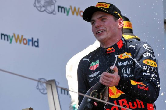 Race winner Max Verstappen (NLD) Red Bull Racing celebrates on the podium.