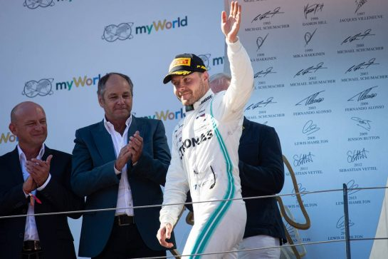 Valtteri Bottas (FIN) Mercedes AMG F1 celebrates his third position on the podium.