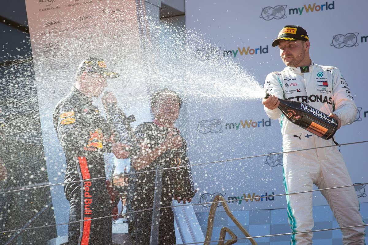 Valtteri Bottas (FIN) Mercedes AMG F1 celebrates his third position on the podium.