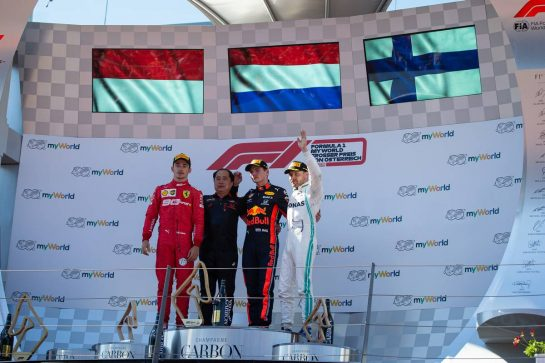 The podium (L to R): Charles Leclerc (MON) Ferrari, second; Toyoharu Tanabe (JPN) Honda Racing F1 Technical Director; Max Verstappen (NLD) Red Bull Racing, race winner; Valtteri Bottas (FIN) Mercedes AMG F1, third.