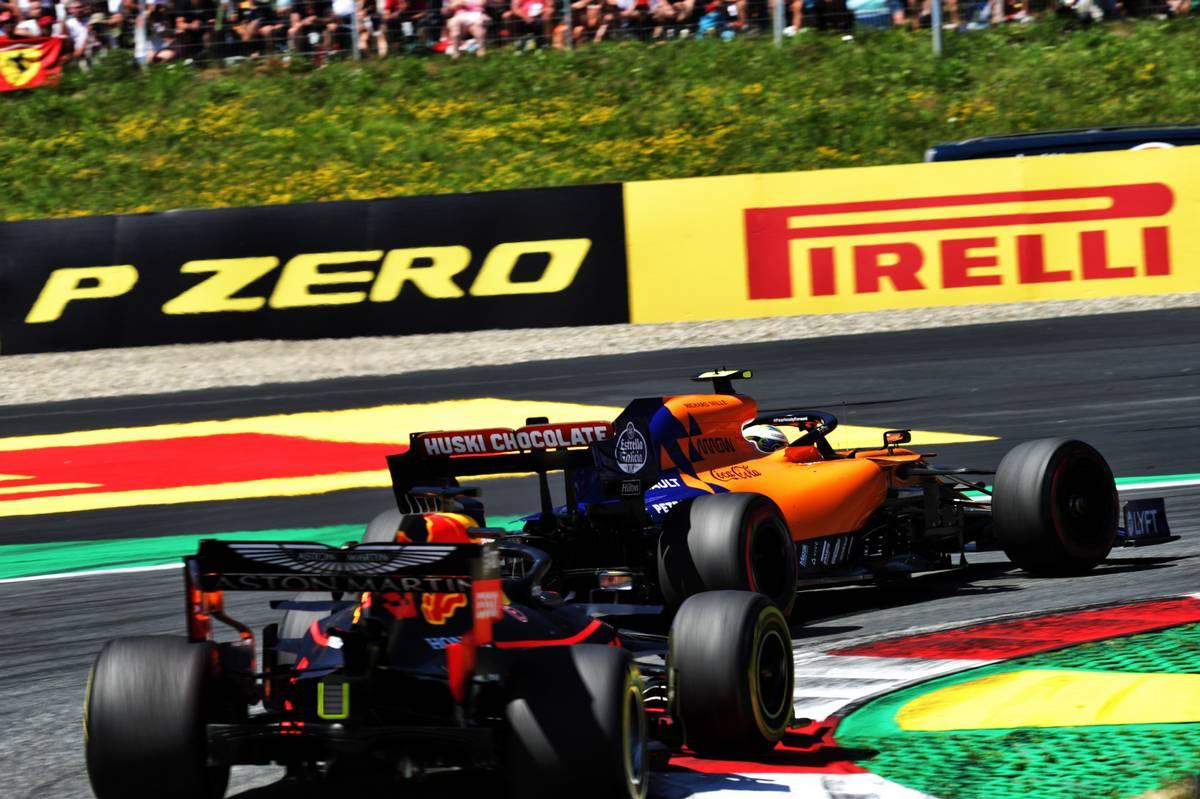 Lando Norris (GBR) McLaren MCL34 leads Max Verstappen (NLD) Red Bull Racing RB15.