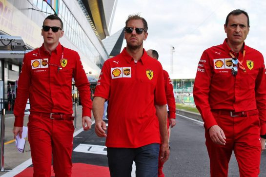 Sebastian Vettel (GER) Ferrari walks the circuit with the team. 11.07.2019. Formula 1 World Championship, Rd 10, British Grand Prix, Silverstone, England, Preparation Day. - www.xpbimages.com, EMail: requests@xpbimages.com - copy of publication required for printed pictures. Every used picture is fee-liable. © Copyright: Batchelor / XPB Images