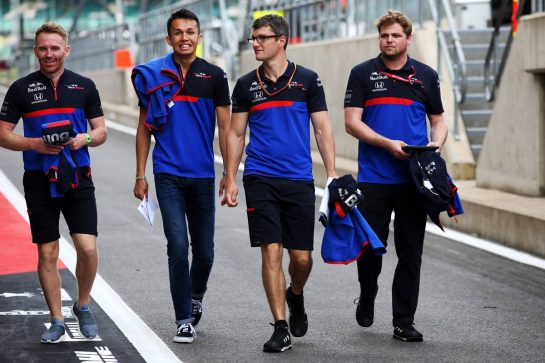 Alexander Albon (THA) Scuderia Toro Rosso walks the circuit with the team. 11.07.2019. Formula 1 World Championship, Rd 10, British Grand Prix, Silverstone, England, Preparation Day. - www.xpbimages.com, EMail: requests@xpbimages.com - copy of publication required for printed pictures. Every used picture is fee-liable. © Copyright: Batchelor / XPB Images