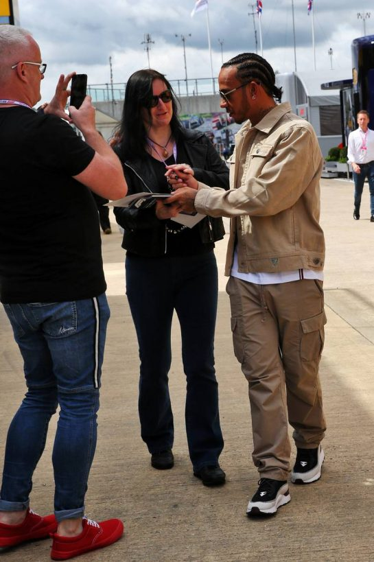 Lewis Hamilton (GBR) Mercedes AMG F1 signs autographs for the fans. 11.07.2019. Formula 1 World Championship, Rd 10, British Grand Prix, Silverstone, England, Preparation Day. - www.xpbimages.com, EMail: requests@xpbimages.com - copy of publication required for printed pictures. Every used picture is fee-liable. © Copyright: Batchelor / XPB Images