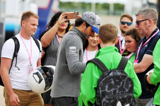 Carlos Sainz Jr (ESP) McLaren signs autographs for the fans. 11.07.2019. Formula 1 World Championship, Rd 10, British Grand Prix, Silverstone, England, Preparation Day. - www.xpbimages.com, EMail: requests@xpbimages.com - copy of publication required for printed pictures. Every used picture is fee-liable. © Copyright: Moy / XPB Images
