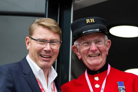 Mika Hakkinen (FIN) with a Chelsea Pensioner. 11.07.2019. Formula 1 World Championship, Rd 10, British Grand Prix, Silverstone, England, Preparation Day.  - www.xpbimages.com, EMail: requests@xpbimages.com - copy of publication required for printed pictures. Every used picture is fee-liable. © Copyright: Rew / XPB Images