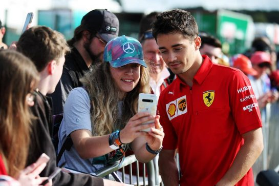 Charles Leclerc (MON) Ferrari with fans.