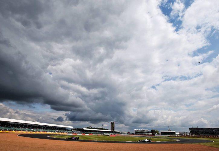 Daniil Kvyat (RUS) Scuderia Toro Rosso STR14 leads Valtteri Bottas (FIN) Mercedes AMG F1 W10.