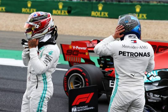 (L to R): Lewis Hamilton (GBR) Mercedes AMG F1 with team mate and pole sitter Valtteri Bottas (FIN) Mercedes AMG F1 in qualifying parc ferme.