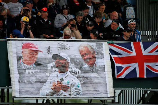 Lewis Hamilton (GBR) Mercedes AMG F1 banner with fans in the grandstand. 13.07.2019. Formula 1 World Championship, Rd 10, British Grand Prix, Silverstone, England, Qualifying Day. - www.xpbimages.com, EMail: requests@xpbimages.com - copy of publication required for printed pictures. Every used picture is fee-liable. © Copyright: Photo4 / XPB Images