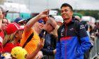 Alexander Albon (THA) Scuderia Toro Rosso with fans.