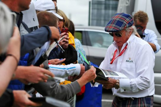 Jackie Stewart (GBR) signs autographs for the fans.