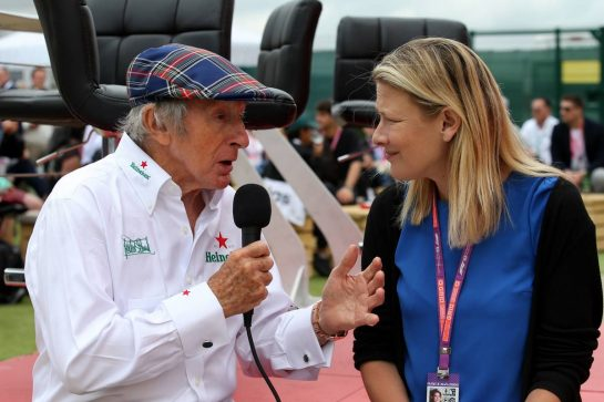 (L to R): Jackie Stewart (GBR) with Jennie Gow (GBR) BBC Radio 5 Live Pitlane Reporter.