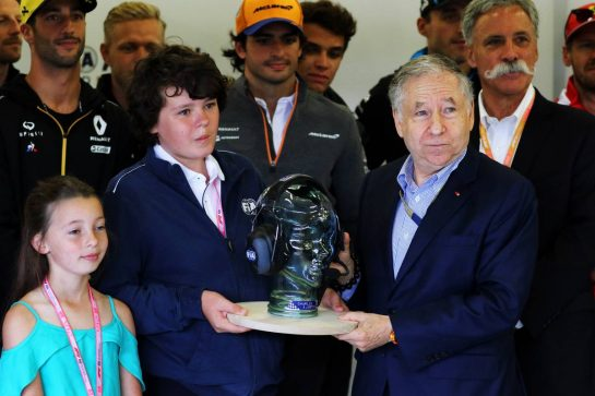 Jean Todt (FRA) FIA President with Justin and Charlotte Whiting (GBR).