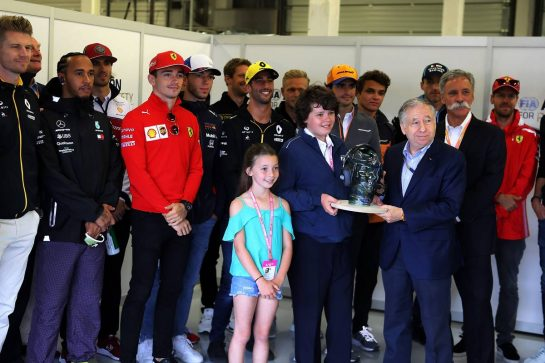 Jean Todt (FRA) FIA President with Justin and Charlotte Whiting (GBR), Ross Brawn (GBR) Managing Director, Motor Sports; Chase Carey (USA) Formula One Group Chairman; and the drivers.
