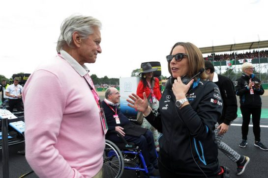 (L to R): Michael Douglas (USA) Actor with Claire Williams (GBR) Williams Racing Deputy Team Principal on the grid.