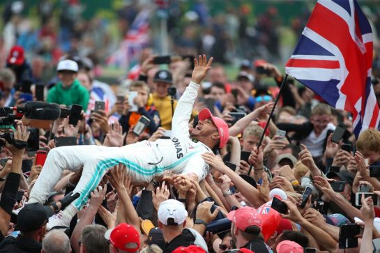 1st place Lewis Hamilton (GBR) Mercedes AMG F1 W10 crowd surfing.