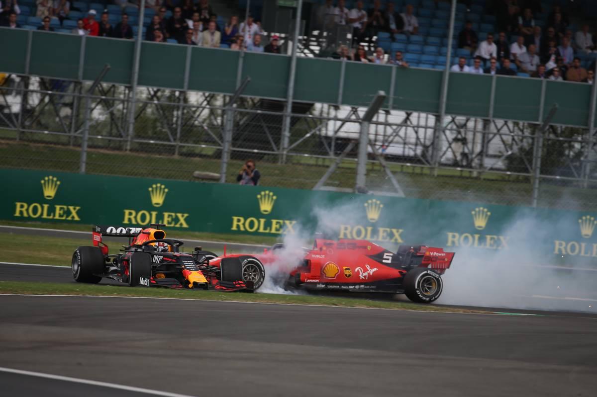 Sebastian Vettel (GER) Ferrari SF90 crashes into the back of Max Verstappen (NLD) Red Bull Racing RB15.