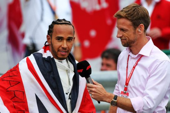 Race winner Lewis Hamilton (GBR) Mercedes AMG F1 in parc ferme with Jenson Button (GBR) Sky Sports F1 Presenter.