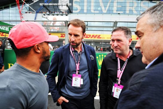 (L to R): Nicolas Hamilton (GBR) with Gareth Southgate (GBR) England Football Manager on the grid.