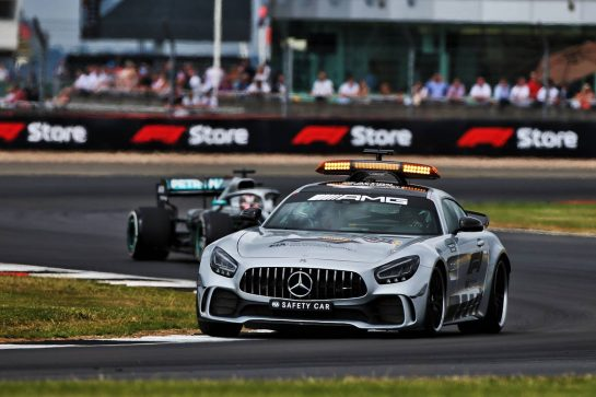 Lewis Hamilton (GBR) Mercedes AMG F1 W10 leads behind the FIA Safety Car.