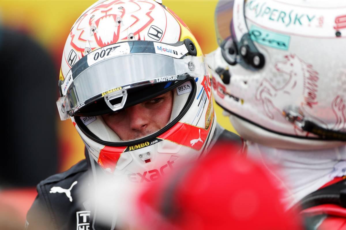 Max Verstappen (NLD) Red Bull Racing with Sebastian Vettel (GER) Ferrari in parc ferme.