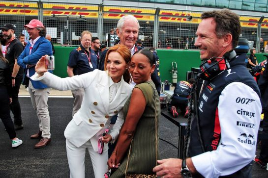 (L to R): Geri Horner (GBR) Singer with Mel B (GBR) Singer and Christian Horner (GBR) Red Bull Racing Team Principal on the grid.