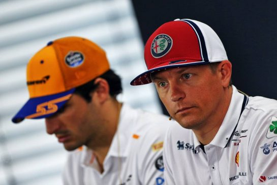 Kimi Raikkonen (FIN) Alfa Romeo Racing and Carlos Sainz Jr (ESP) McLaren in the FIA Press Conference. 25.07.2019. Formula 1 World Championship, Rd 11, German Grand Prix, Hockenheim, Germany, Preparation Day. - www.xpbimages.com, EMail: requests@xpbimages.com - copy of publication required for printed pictures. Every used picture is fee-liable. © Copyright: Moy / XPB Images