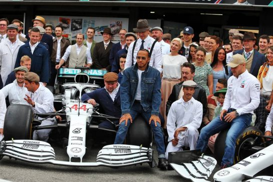 Lewis Hamilton (GBR) Mercedes AMG F1, Toto Wolff (GER) Mercedes AMG F1 Shareholder and Executive Director; Valtteri Bottas (FIN) Mercedes AMG F1, and the team wear vintage clothing to celebrate 125 years in motorsport. 28.07.2019. Formula 1 World Championship, Rd 11, German Grand Prix, Hockenheim, Germany, Race Day. - www.xpbimages.com, EMail: requests@xpbimages.com - copy of publication required for printed pictures. Every used picture is fee-liable. © Copyright: Moy / XPB Images