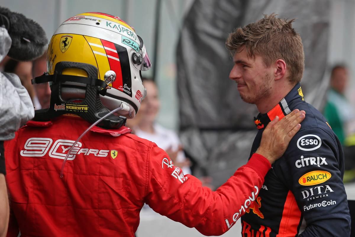Sebastian Vettel (GER), Scuderia Ferrari and Max Verstappen (NLD), Red Bull Racing